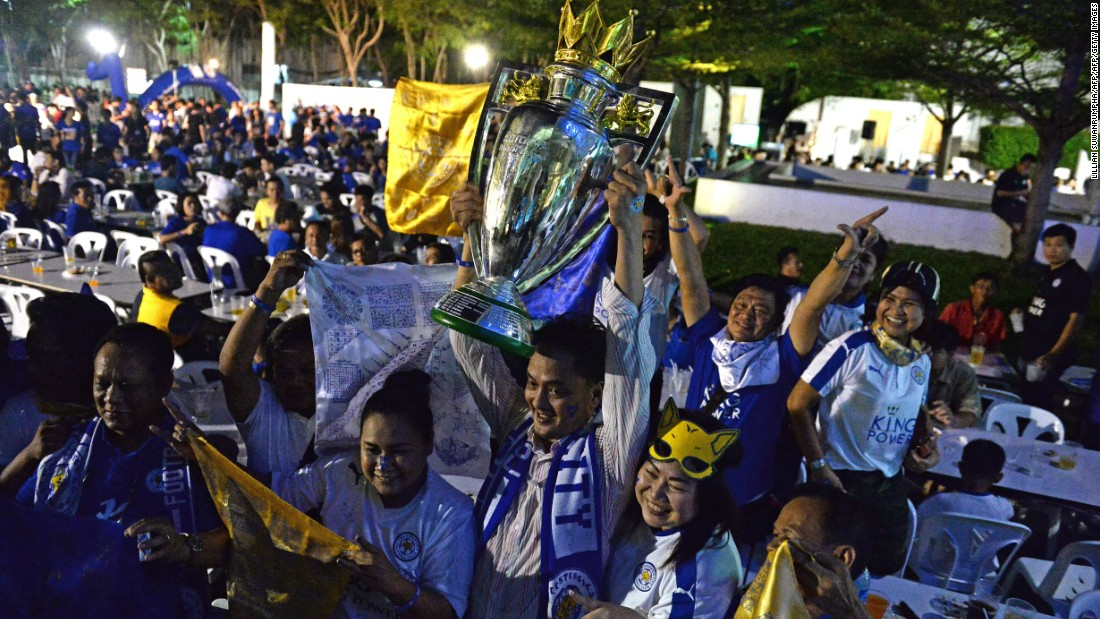 Leicester fans in Bangkok pose with a replica Premier League trophy before a live screening of the Leicester vs. Everton match on the penultimate weekend of the Premier League season. Leicester, confirmed as champion when rival Tottenham failed to win earlier that week, triumphed 3-1 to add even more gloss to their remarkable triumph.
