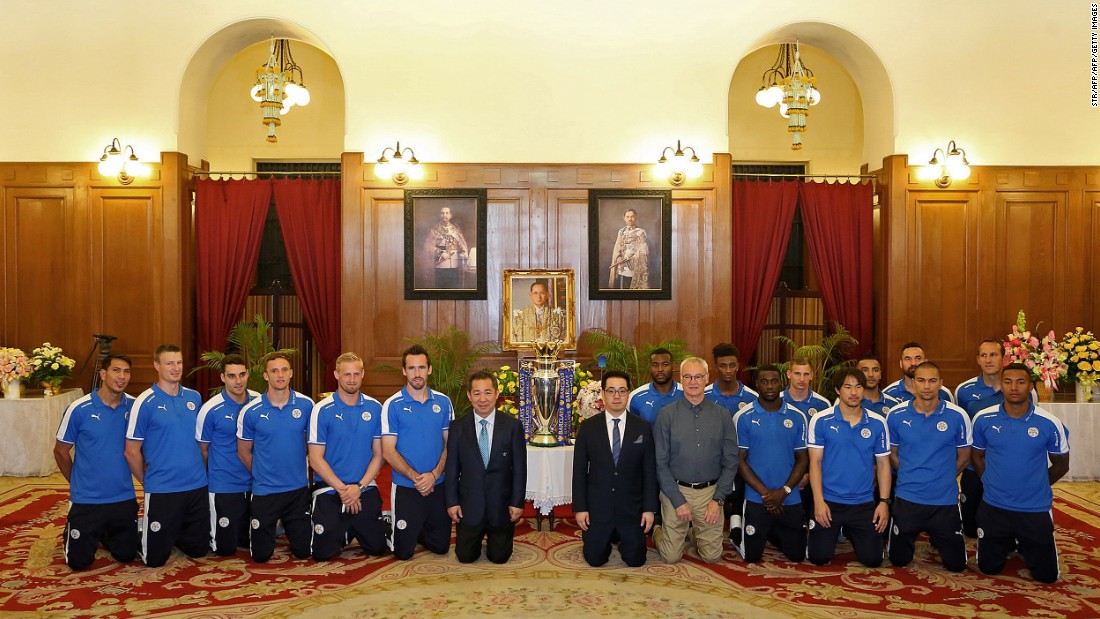 "Before the parade, Ranieri, Vichai Srivaddhanaprabha (first row, seventh left) and his son, Leicester vice-chairman Aiyawatt ""Top"" Srivaddhanaprabha (first row, sixth right), joined the players to kneel and pay their respects to a picture of Thai King Bhumibol Adulyadej, the world's longest-serving monarch, as they received a royal seal of approval at Bangkok's Grand Palace. Aiyawatt said the players were ""massive in Thailand now."""