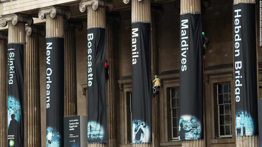 Greenpeace activists hang banners on the front of the British Museum on May 19, 2016 in London, England.