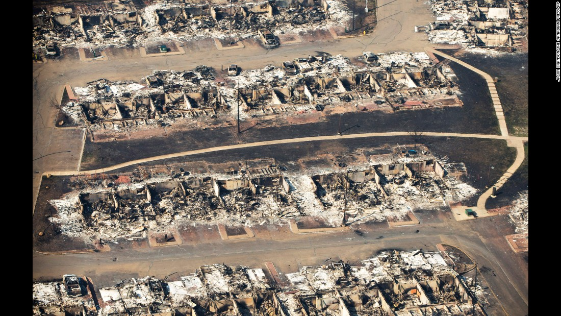 "An aerial photo shows a devastated neighborhood in Fort McMurray, Alberta, on Friday, May 13. The mammoth inferno devastating northern Alberta <a href=""http://www.cnn.com/2016/05/18/americas/alberta-wildfire-canada-fort-mcmurray/"" target=""_blank"">has destroyed more than 877,000 acres. </a>That's more than four times the size of New York City."