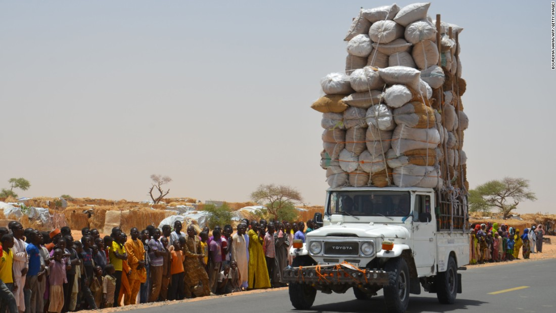 An overloaded car travels through the Assaga refugee camp in Diffa, Niger, on Tuesday, May 17. More than 240,000 people are in Niger camps after being displaced by the Nigerian terrorist group Boko Haram.
