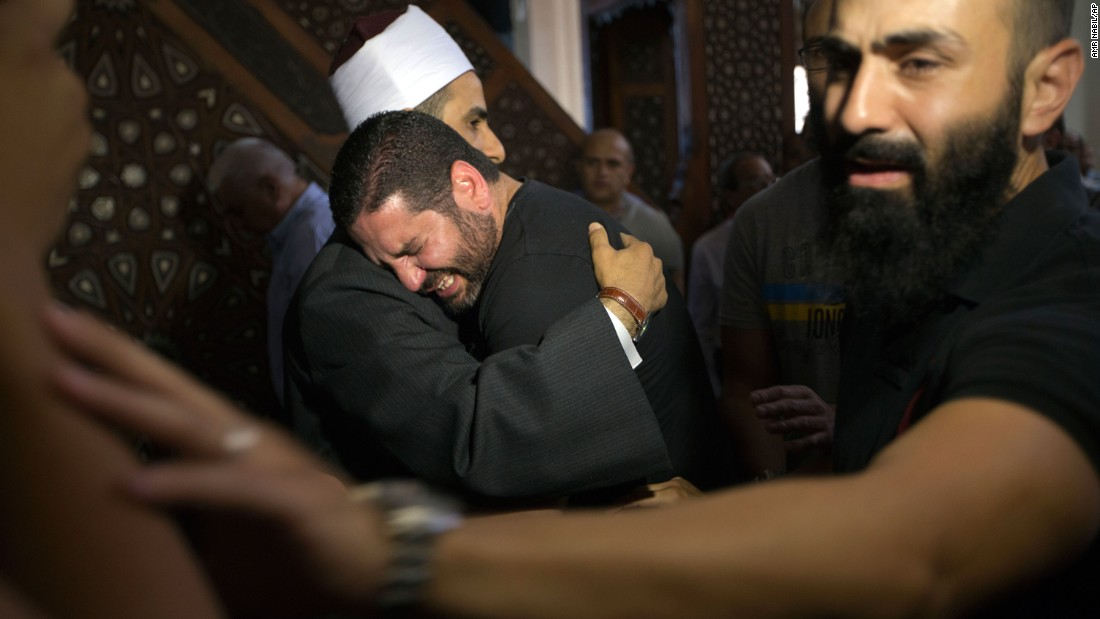 Samir Abdel Bary, imam of Cairo's al Thawrah Mosque, consoles Tarek Abu Laban, who had four relatives on the flight, on Friday, May 20.