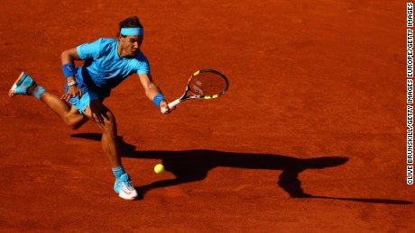 PARIS, FRANCE - JUNE 03:  Rafael Nadal of Spain plays a forehand in his Men's quarter final match against Novak Djokovic of Serbia on day eleven of the 2015 French Open at Roland Garros on June 3, 2015 in Paris, France.  (Photo by Clive Brunskill/Getty Images)