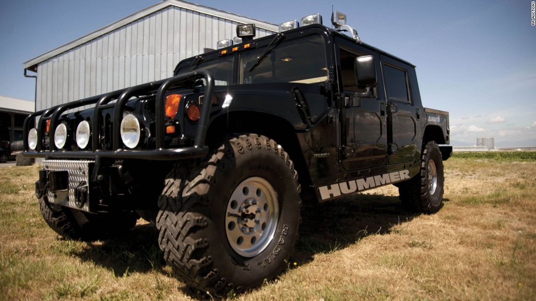 The colossal Hummer boasts off-road lights, a 360-degree spotlight, a grille guard, diamond-plate bumpers, oversized off-road wheels and tires and an external PA system with three sirens.