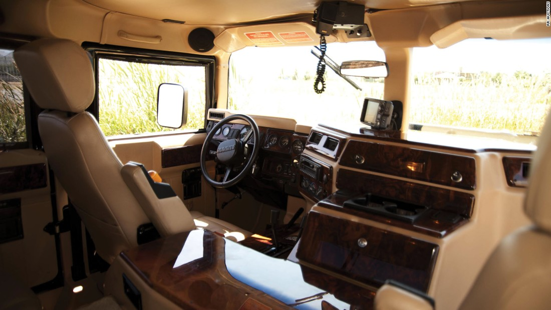 The interior is trimmed in burl wood with beige leather upholstery, and is fit with a 12-disc Clarion sound system, Sony GPS, a central tire inflation system.