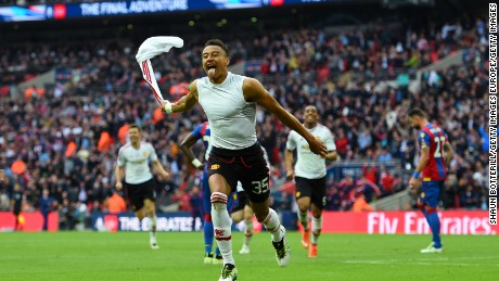 Jesse Lingard celebrates scoring the winning goal in the 2016 FA Cup final.