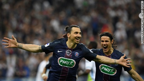 Paris Saint-Germain's Swedish forward Zlatan Ibrahimovic (L) celebrates with Paris Saint-Germain's Uruguayan forward Edinson Cavani (R) after scoring a goal during the French Cup final.
