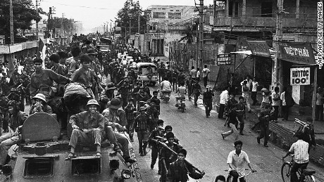 Jubilant communist troops make their way to the center of Saigon as the city fell under their control, April 30, 1975.