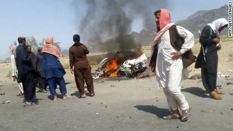 This photograph taken on May 21, 2016 shows Pakistani local residents gathering around a destroyed vehicle hit by a drone strike in which Afghan Taliban Chief Mullah Akhtar Mansour was believed to be travelling in the remote town of Ahmad Wal in Balochistan, around 160 kilometres west of Quetta. Afghan authorities scrambled May 22 to confirm the fate of Taliban leader Mullah Akhtar Mansour after US officials said he was likely killed in drone strikes -- a potential blow to the resurgent militant movement.  / AFP / -        (Photo credit should read -/AFP/Getty Images)