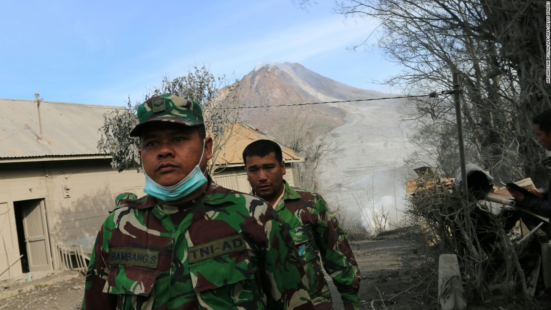 Indonesian soldiers conduct search and rescue operations Sunday, May 22 in a North Sumatra village after the volcano eruption.