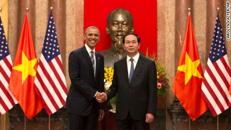 U.S. President Barack Obama, left,  and Vietnamese President Tran Dai Quang shake hands at the Presidential Palace in Hanoi, Vietnam, Monday, May 23, 2016. The president is on a weeklong trip to Asia as part of his effort to pay more attention to the region and boost economic and security cooperation. (AP Photo/Carolyn Kaster)
