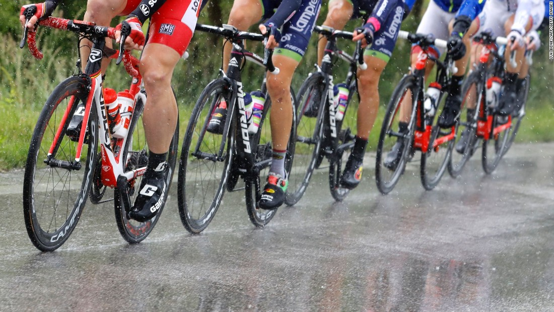 Cyclists ride under heavy rain during the 12th stage of the 99th Giro d'Italia, Tour of Italy, from Noale to Bibione on May 19.