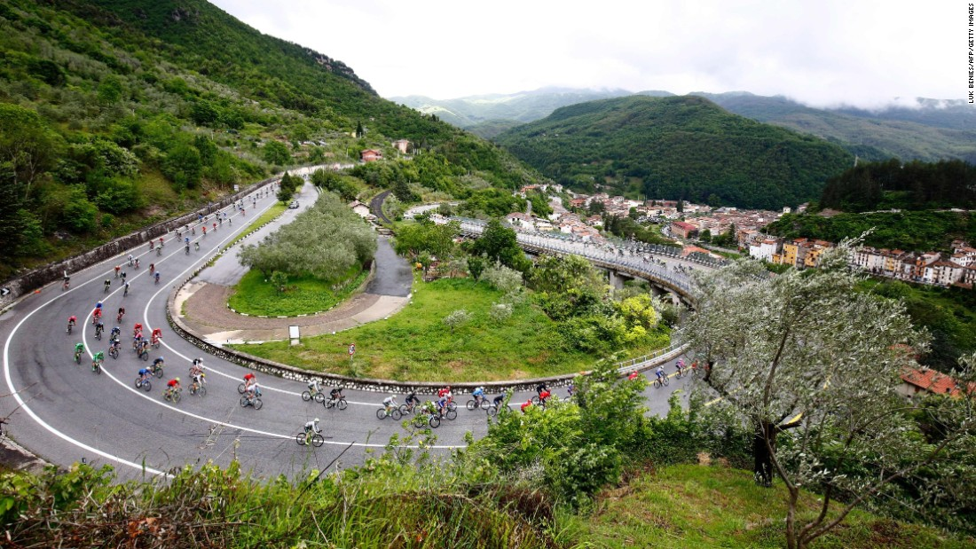 The pack passes a curve on a mountain road during the 7th stage of 99th Giro d'Italia, Tour of Italy, from Sulmona to Foligno of 211 km on May 13, in Foligno, Italy.