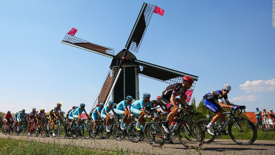 The peloton passes a windmill during stage two of the 2016 Giro d'Italia, a 190km stage from Arnhem to Nijmegen on May 07, in Nijmegen, Netherlands.