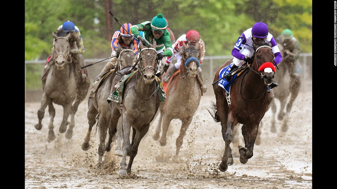 "Jockey Kent Desormeaux, in green, <a href=""http://www.cnn.com/2016/05/21/sport/preakness-stakes-exaggerator/index.html"" target=""_blank"">rides Exaggerator to victory</a> in the Preakness Stakes on Saturday, May 21. The track in Baltimore was very muddy because of a cold rain that fell all day."