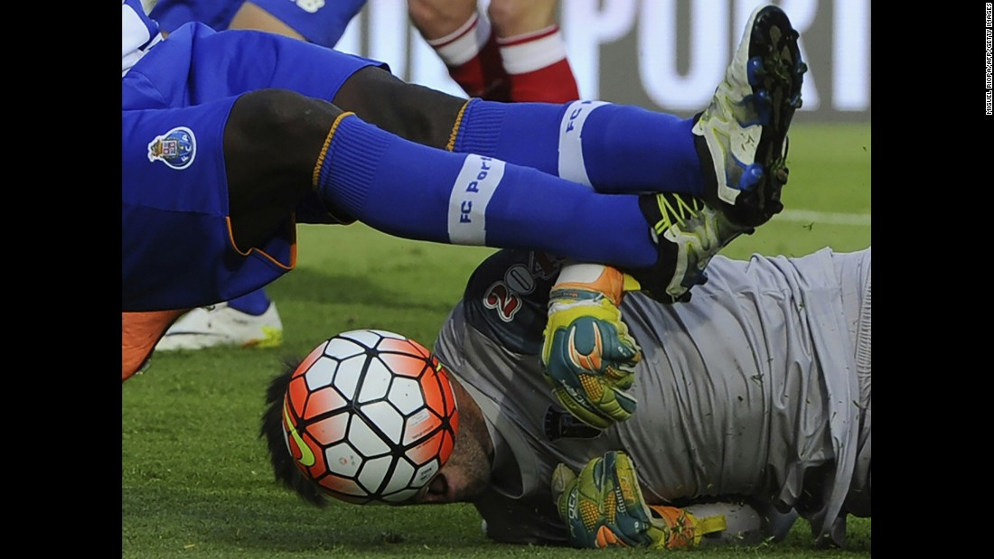 The ball obscures the face of Sporting Braga goalkeeper Carlos Marafona as he falls next to Porto's Silvestre Varela on Sunday, May 22. Braga would go on to win the Portuguese Cup on penalty kicks.