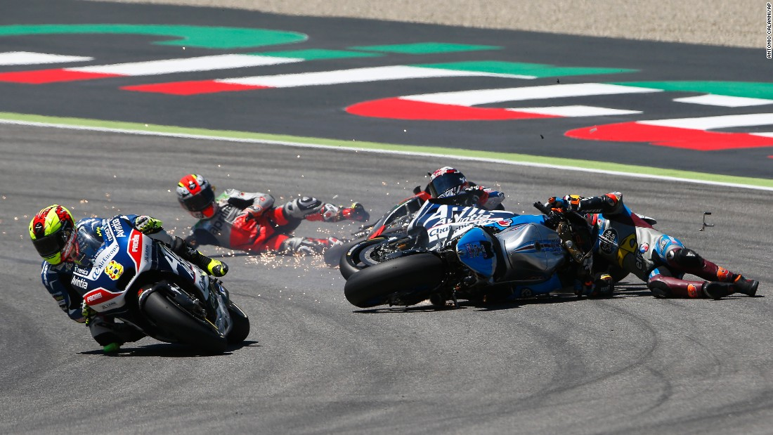 "Hector Barbera, left, speeds past a first-lap crash during <a href=""http://www.cnn.com/2016/05/23/motorsport/motogp-italy-valentino-rossi-vinales/index.html"" target=""_blank"">the MotoGP race in Italy</a> on Sunday, May 22. Behind Barbera, from left, are Alvaro Bautista, Loris Baz and Jack Miller. Bautista and Miller were OK after the wreck, but <a href=""http://www.eurosport.com/moto/baz-could-face-sideline-spell-after-mugello-crash_sto5582593/story.shtml"" target=""_blank"">Baz suffered a broken foot.</a>"