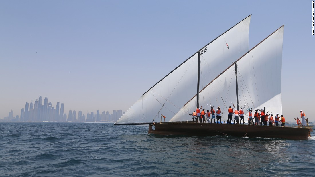 Sailors aboard the Zilzal celebrate after winning the Al Gaffal Dhow Race near Dubai, United Arab Emirates, on Friday, May 20.