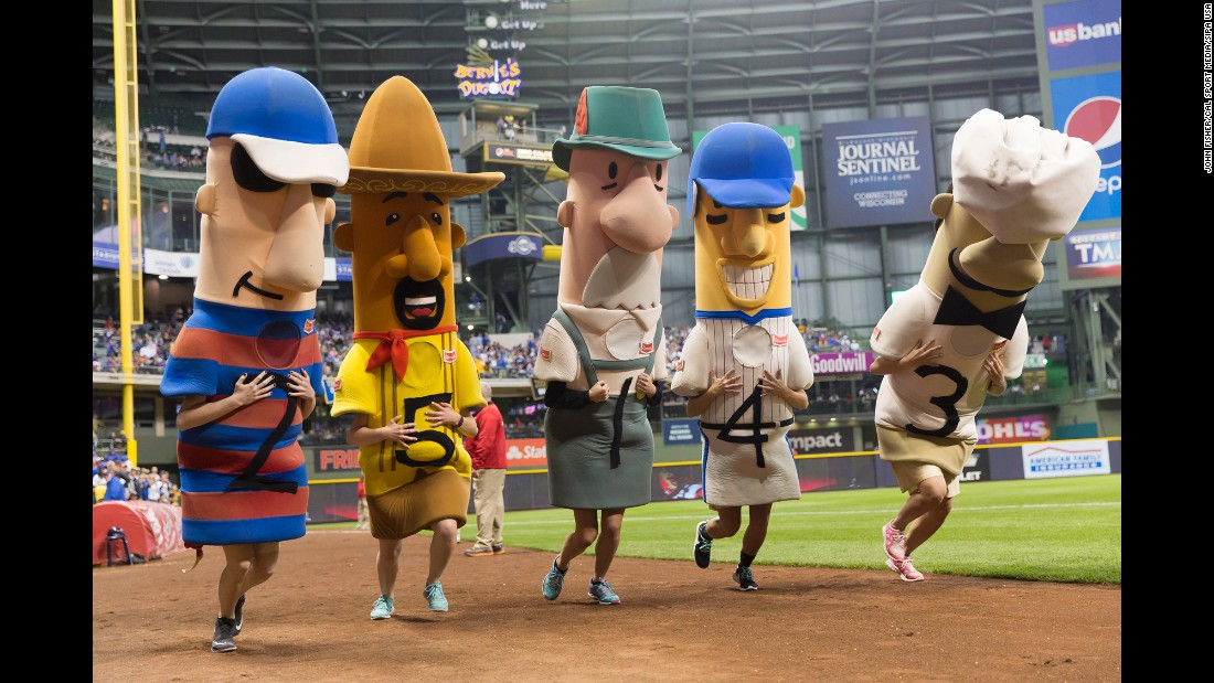 "Mascots race in <a href=""http://milwaukee.brewers.mlb.com/mil/fan_forum/racing_sausages.jsp"" target=""_blank"">the traditional Sausage Race</a> during a Milwaukee Brewers baseball game on Wednesday, May 18. From left are Polish Sausage, Chorizo, Bratwurst, Hot Dog and Italian Sausage."