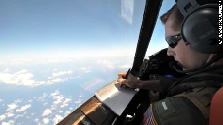 U.S. Navy LT JG Curtis Calabrese takes notes on board of a U.S. Navy Lockheed P-3C Orion patrol aircraft from Sigonella, Sicily, Sunday, May 22, 2016, searching the area in the Mediterranean Sea where the Egyptair flight 804 en route from Paris to Cairo went missing on May 19. Search crews found floating human remains, luggage and seats from the doomed EgyptAir jetliner Friday but face a potentially more complex task in locating bigger pieces of wreckage and the black boxes vital to determining why the plane plunged into the Mediterranean. (AP Photo/Salvatore Cavalli)