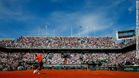 PARIS, FRANCE - JUNE 07:  Novak Djokovic of Serbia serves in the Men's Singles Final against Stanislas Wawrinka of Switzerland on day fifteen of the 2015 French Open at Roland Garros on June 7, 2015 in Paris, France.  (Photo by Julian Finney/Getty Images)
