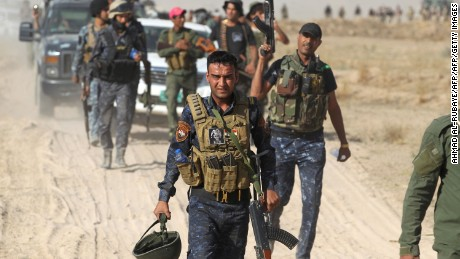Iraqi pro-government forces gather as they advance towards the city of Falluja on May 23, 2016, as part of a major assault to retake the city from Islamic State (IS) group.