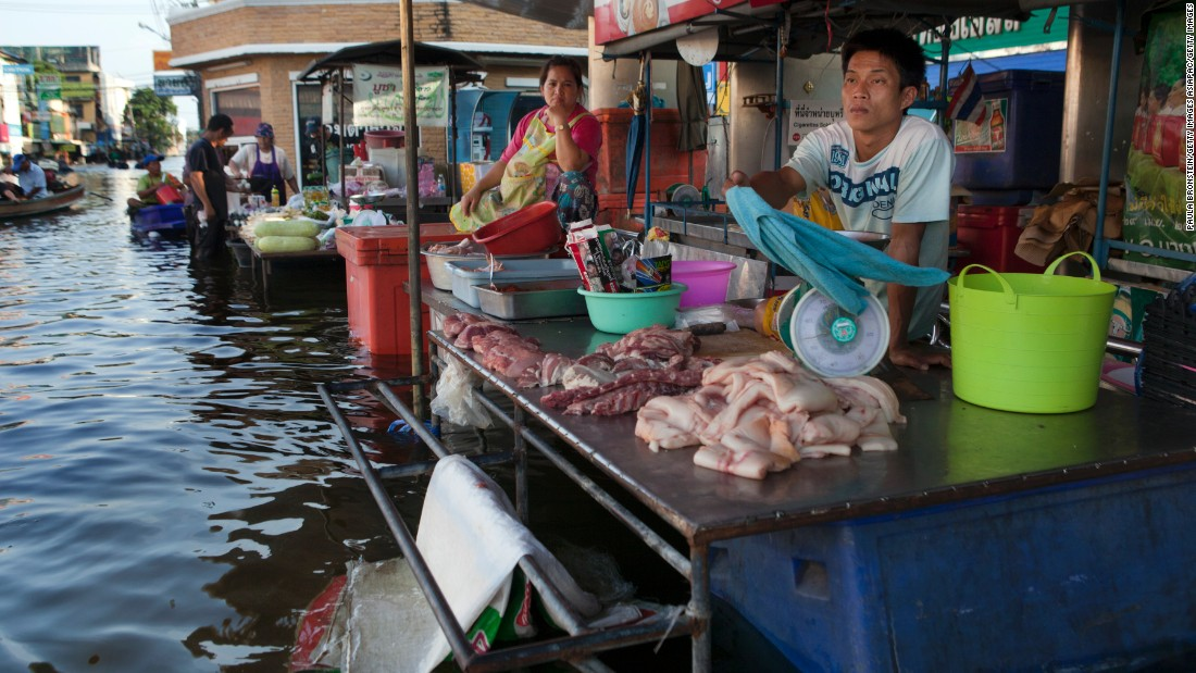 Vendors wait for business at a floating market in Bangbuathong, Thailand.
