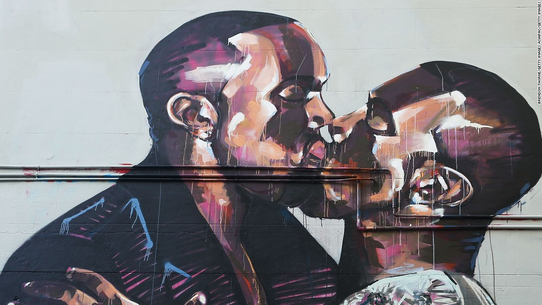 A mural showing hip-hop artist Kanye West kissing himself appeared in Sydney, Australia. The artist, Scott Marsh, was inspired by a photo of West kissing his wife, Kim Kardashian-West.
