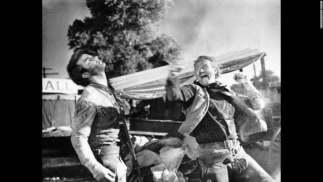 "Wayne, right, acts out a fight scene for the 1948 film ""Red River."" ""Mr. Wayne seemed the embodiment of those qualities of spirit and character that Americans aspired to and admired,"" wrote Martin Weil of the Washington Post. ""They were the frontier virtues, as America knew them or believed them to be: energy, rugged honesty, self-reliance and a willingness -- above all, perhaps -- to fight for what he believed in."""