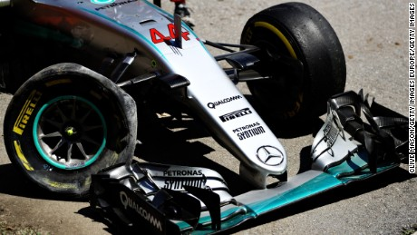 Lewis Hamilton's battered Mercedes lies at the side of the Circuit de Barcelona-Catalunya.