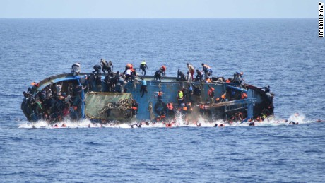 Terrifying scene as migrant ship capsizes