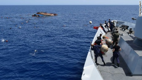 Rescuers try to save migrants from a capsized boat off Libya on Wednesday. Another boat capsized Thursday.