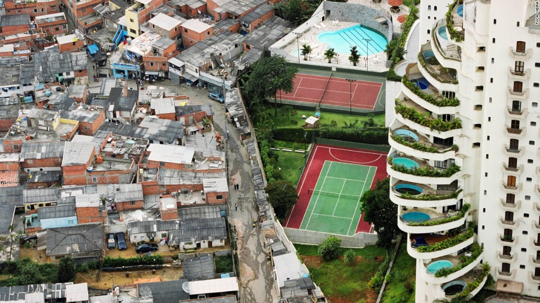 "This image of Sao Paulo's Paraisopólis (""Paradise City"") shows the favela's stark contrast of rich and poor."