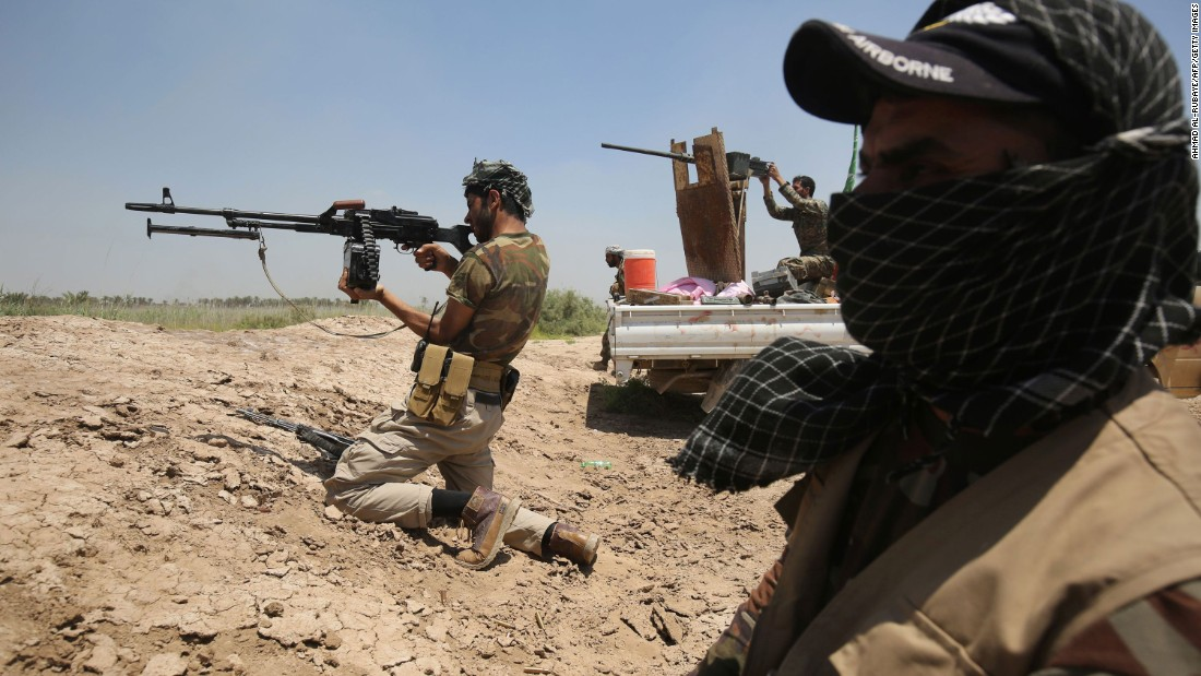 Iraqi government forces take position east of Falluja on Wednesday, May 25.