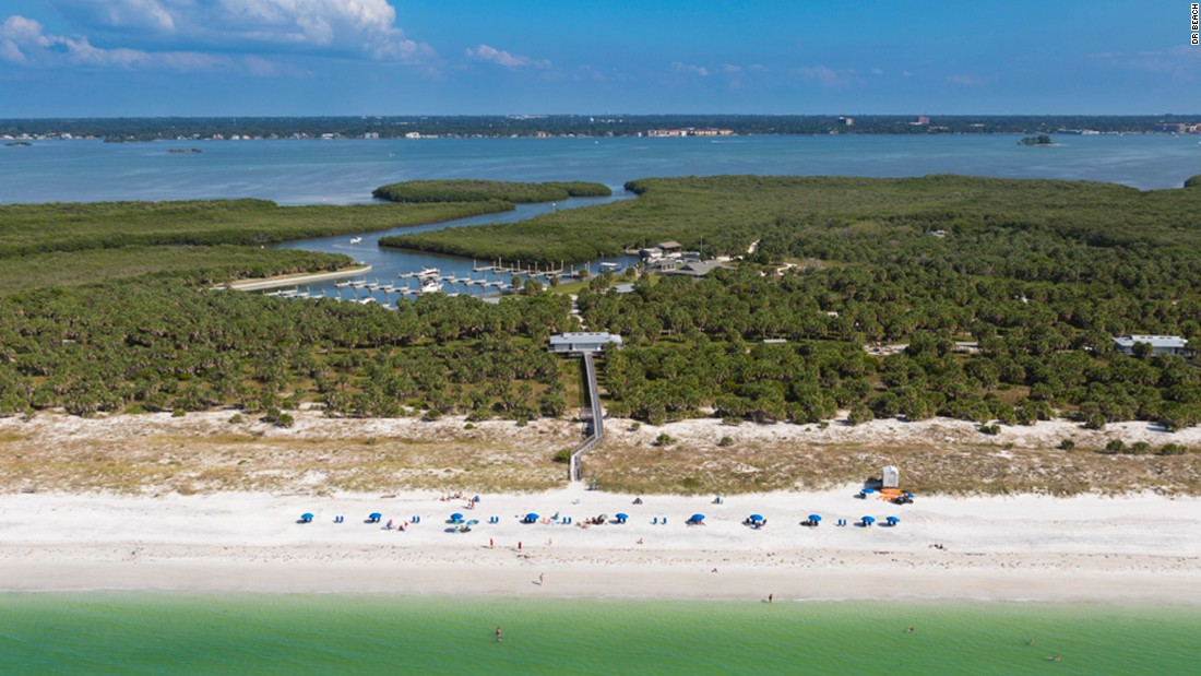 Caladesi Island State Park in Florida is reached by a long walk from Clearwater  Beach, pedestrian ferry or private boat. The beach is crystalline quartz white sand but the big fun is the kayak and canoe trails through the mangroves.