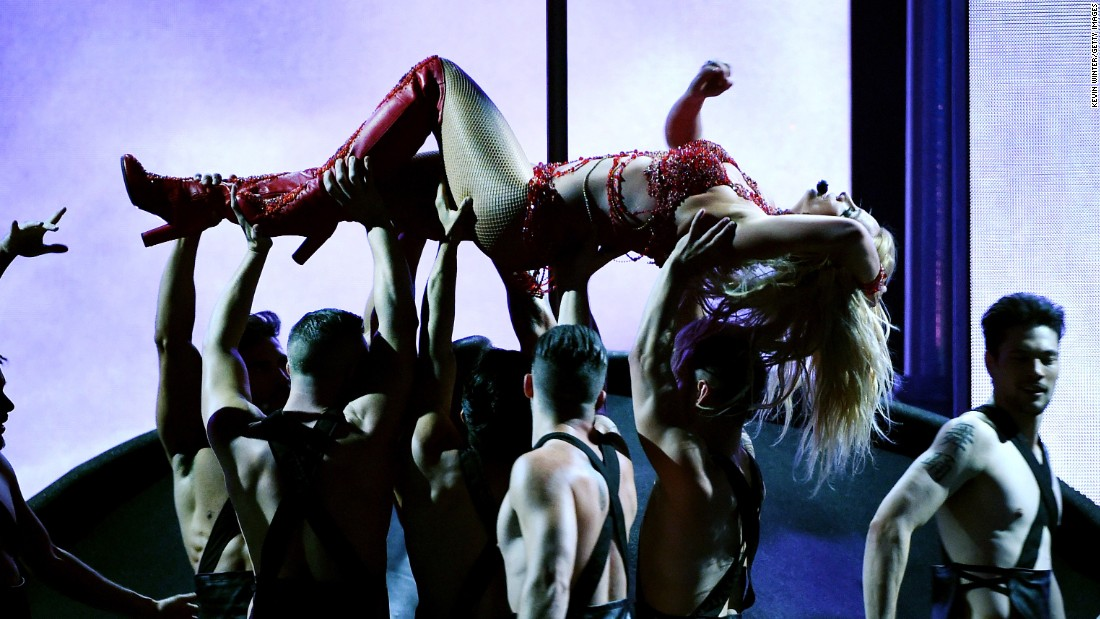 Dancers hold up Britney Spears as she performs at the Billboard Music Awards on Sunday, May 22.
