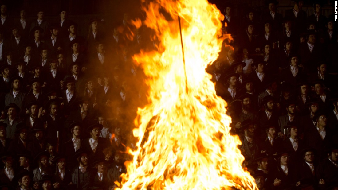 Ultra-Orthodox Jews watch a flame in Jerusalem as they celebrate the Lag B'Omer holiday on Wednesday, May 25.