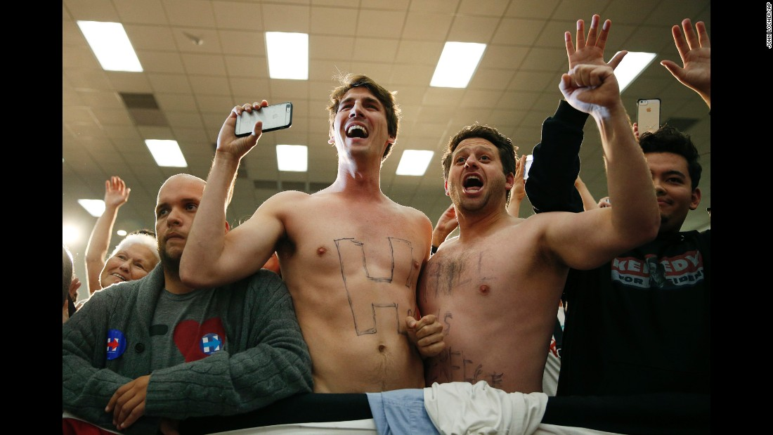 Shirtless men cheer for Democratic presidential candidate Hillary Clinton at a campaign event in Buena Park, California, on Wednesday, May 25.