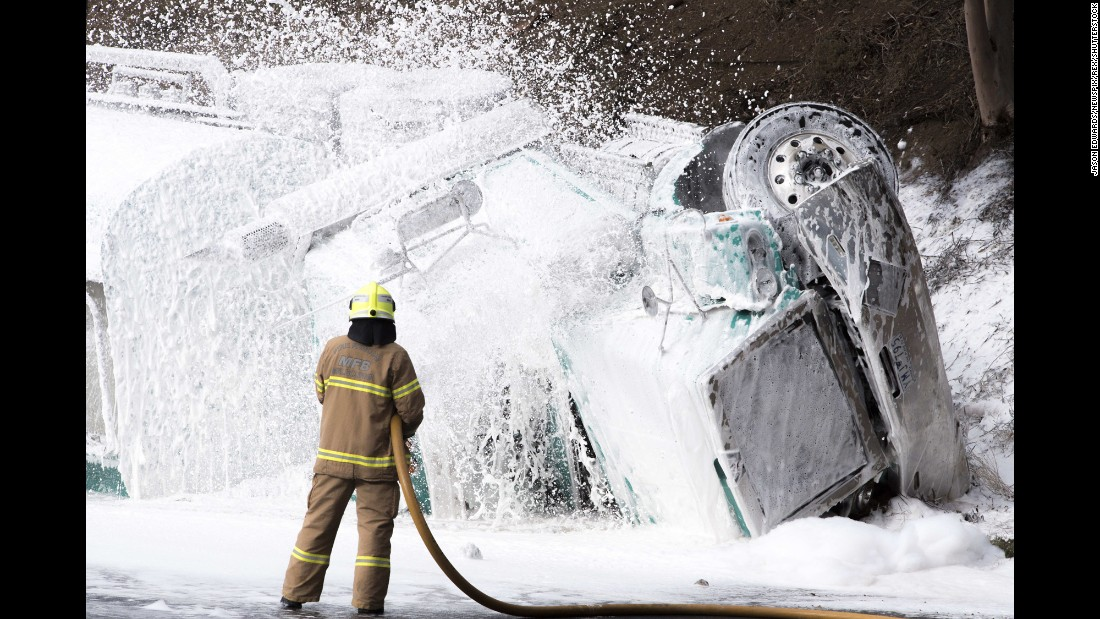 "A firefighter in Melbourne sprays fire retardant at a crash site that involved multiple vehicles, including a gas tanker, on Tuesday, May 24. At least one person was killed, <a href=""http://www.9news.com.au/national/2016/05/24/09/56/at-least-five-injured-after-petrol-tanker-rolls-on-melbourne-freeway"" target=""_blank"">according to Nine News in Australia.</a>"