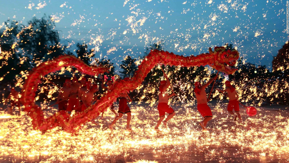 People perform a traditional fire dragon dance at a theme park in Shenyang, China, on Friday, May 20.