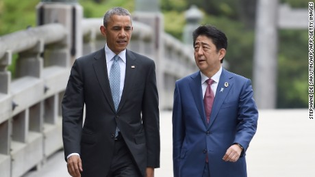 US President Barack Obama walks with Japan's Prime Minister Shinzo Abe as they arrive at Ise-Jingu Shrine in the city of Ise in Mie prefecture, on May 26.