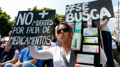 Activists take part in an anti-government demonstration protesting for the shortage of medicaments in Caracas on March 31, 2016. AFP PHOTO/FEDERICO PARRA / AFP / FEDERICO PARRA        (Photo credit should read FEDERICO PARRA/AFP/Getty Images)