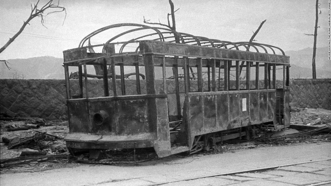 <strong>Then: </strong>A trolley car burned by the bomb remains on the street near Kamiyacho crossing.