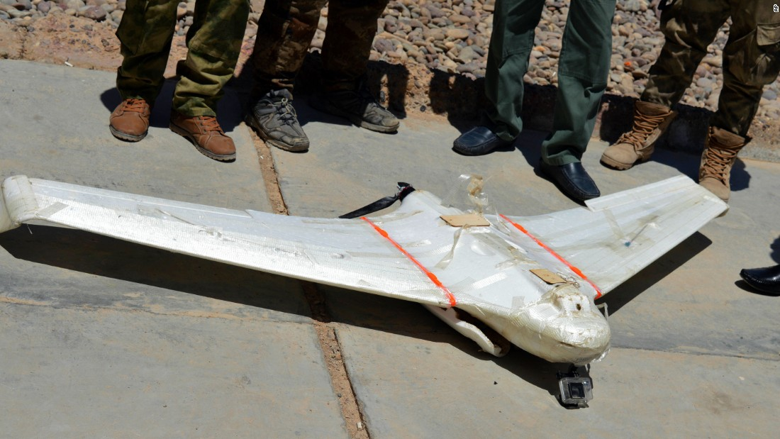 Iraqi security forces surround an ISIS drone that was shot down outside Falluja on May 26.