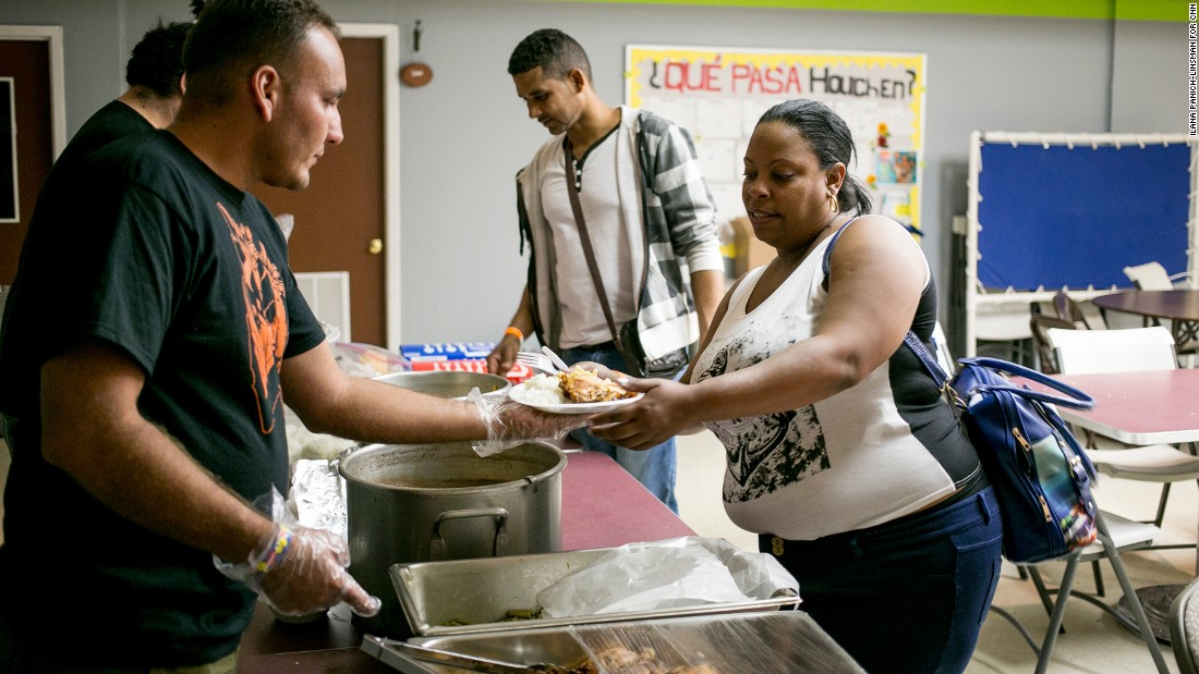 "No matter what time the new immigrants arrive, Julio Rojas Rubio and other volunteers serve them a meal. Rojas, who crossed the border earlier in May, says he loves seeing the looks on his fellow Cubans' faces. ""I feel good knowing that they have also achieved their dream of coming to the United States,"" he says."