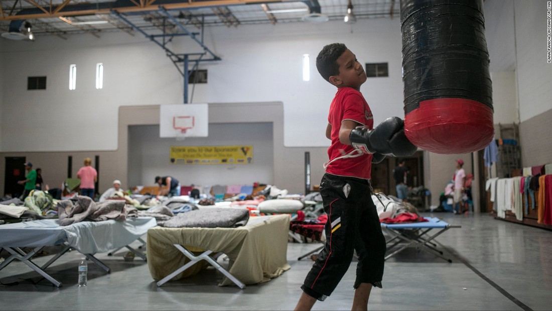Yancarlos Rodriguez Castillo, 10, takes a break at the center while his father tries to figure out where the family will go next.