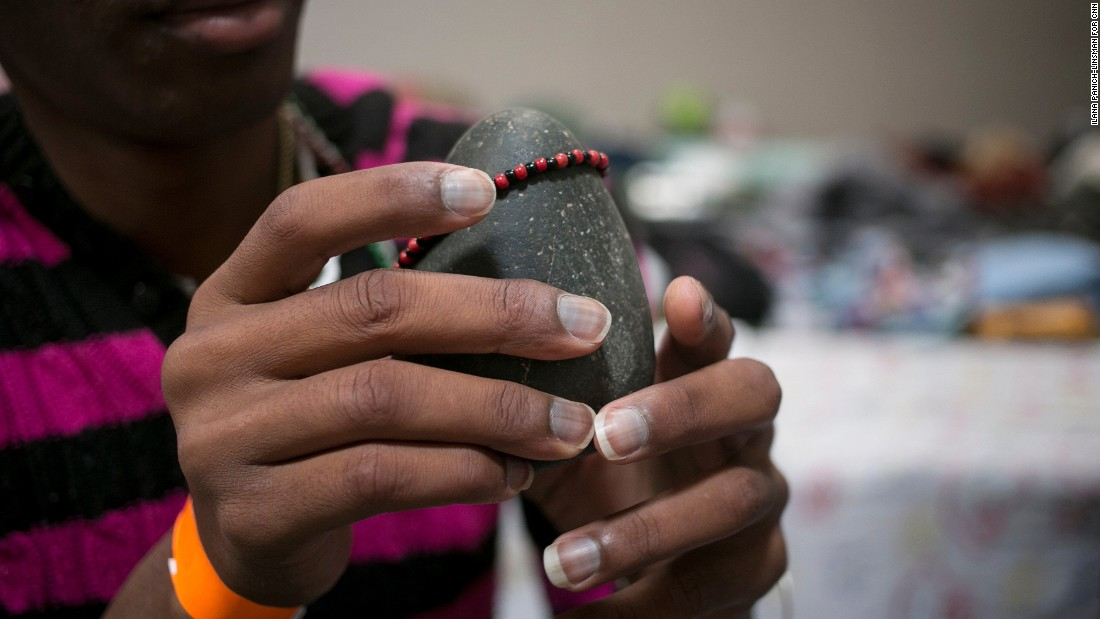 "It's heavy, but Angel Bornell Batista, 27, didn't think twice about packing a sacred Eleguá stone when she left Cuba a year ago, or bringing it along on the three-month journey from Ecuador to the United States. ""I asked him to clear the path for me,"" Bornell said."