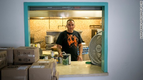 Julio Rojas Rubio was a computer engineer in Cuba; he's been volunteering as a cook at a shelter since arriving in El Paso.