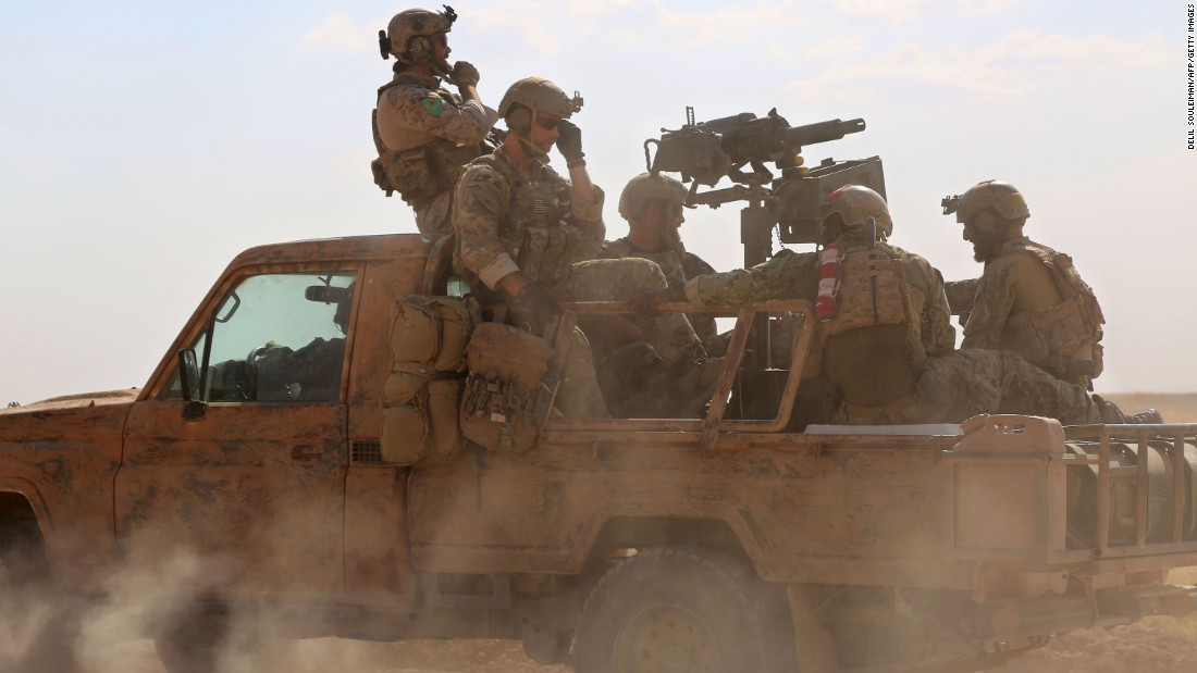 "Armed men in uniform, identified by Syrian Democratic Forces as U.S. special operations forces, ride in the back of a pickup truck in the village of Fatisah, Syria, on Wednesday, May 25. The Pentagon <a href=""http://www.cnn.com/2016/05/26/politics/pentagon-syria-special-operations/index.html"" target=""_blank"">has pushed back on assertions</a> that the U.S. forces were fighting ISIS fighters alongside the Syrian forces they are advising. ""Our forces in Iraq and Syria, their instructions, their mission, is clear that they are not at that leading edge,"" Pentagon press secretary Peter Cook told reporters. U.S. officials have maintained that their forces on the ground are only there to advise and assist local forces in their fight against ISIS."
