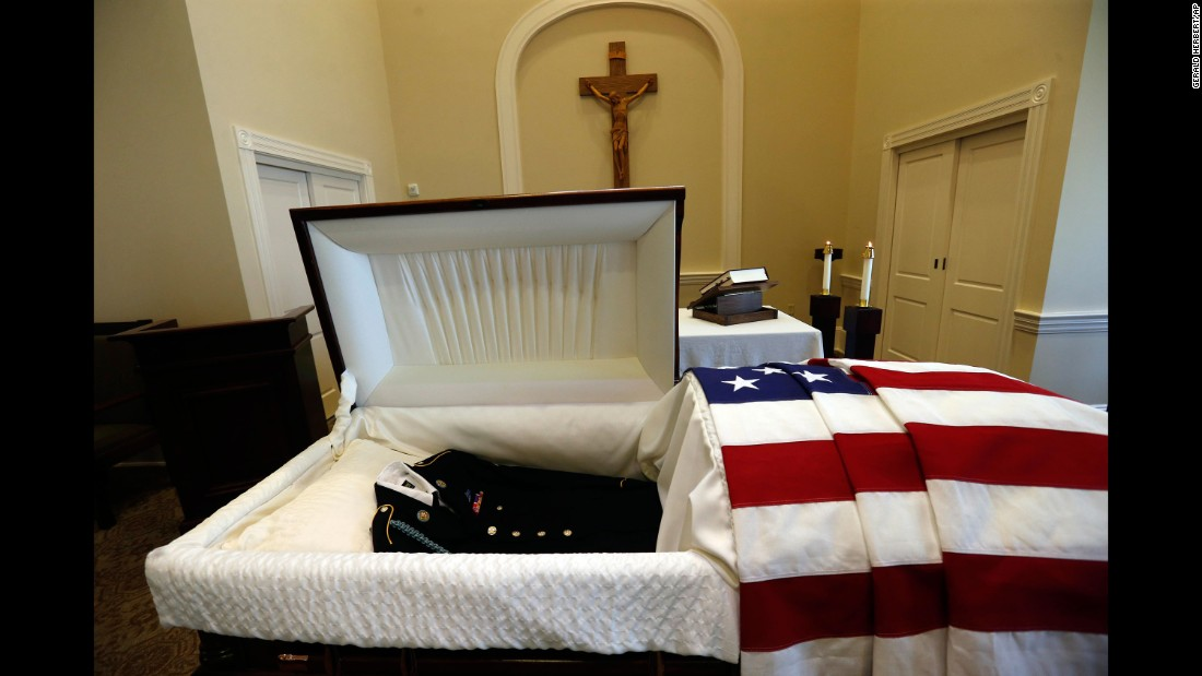 A uniform lies in the casket containing the remains of Army Pvt. Earl Joseph Keating on Monday, May 23. Keating's remains had finally returned to his native New Orleans after being discovered on the island of New Guinea, where he was killed during World War II in 1942.